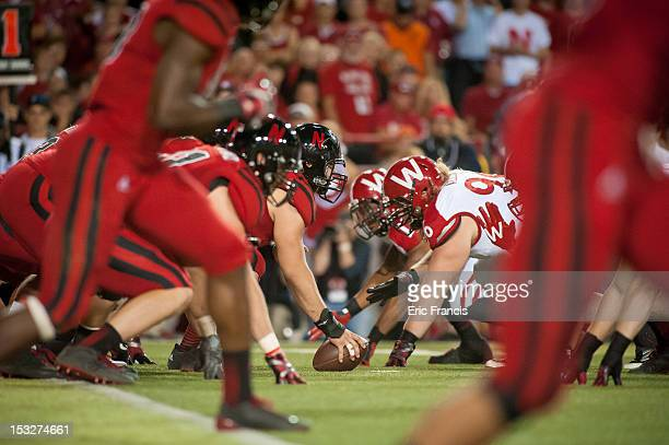 The Nebraska Cornhuskers offensive line waits to take a snap against the Wisconsin Badgers at Memorial Stadium on September 29 2012 in Lincoln...