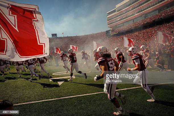 The Nebraska Cornhuskers take the field before their game against the Southern Miss Golden Eagles at Memorial Stadium on September 26 2015 in Lincoln...
