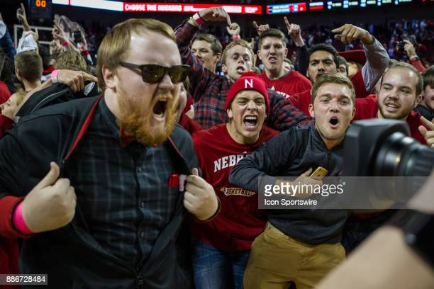 The Nebraska student body storms the court to celebrate their basketball team's win over Minnesota Tuesday December 5th at Pinnacle Bank Arena in...