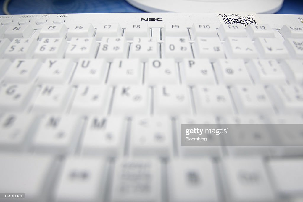 The NEC Corp. logo is displayed on a keyboard for the company's Valuestar desktop computer at the Labi Ofuna electronics store, operated by Yamada Denki Co., in Yokohama City, Kanagawa Prefecture, Japan, on Friday, April 27, 2012. Consumer prices excluding fresh food rose 0.2 percent from the year before, exceeding estimates, a government report showed earlier today. Photographer: Kiyoshi Ota/Bloomberg via Getty Images