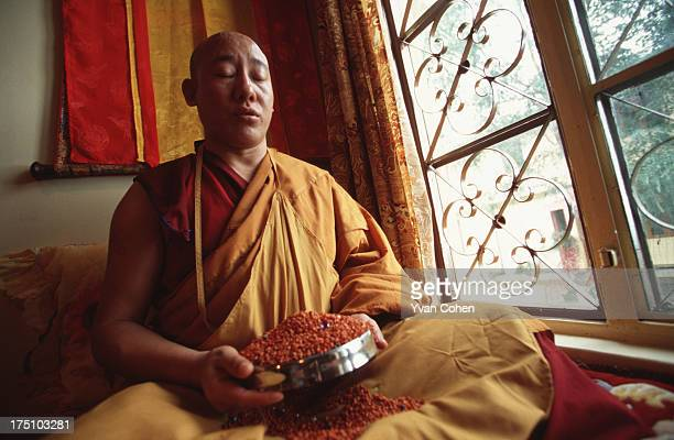 The Nechung Oracle who is reputedly endowed with the power to see where the next incarnation of the Dalai Lama will be born meditates in his room in...