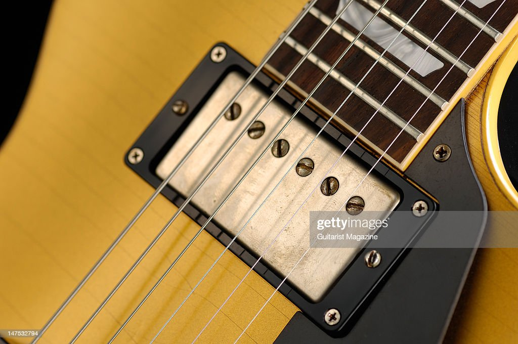 The neck pickup and fretboard of a Gibson Custom Joe