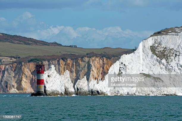 The Needles, Isle of Wight, England, UK, The Needles lighthouse with helipad situated on the outermost chalk rocks. With a backdrop of the multi...