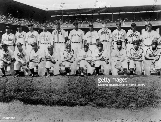 The Negro League East All-Stars pose for a team portrait prior to the 1948 East West Game. The West defeated the East 3-0. Pictured Front Row Buck...