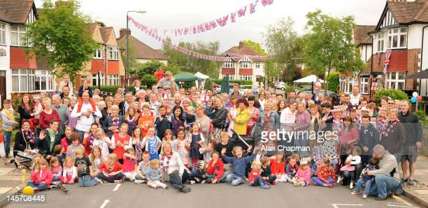The neighbourhood get together for a commemorative photograph before their street party gets underway on June 4 2012 in in New Eltham London United...
