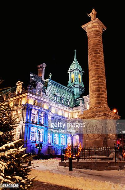 the nelson column and city hall, quebec, canada - place jacques cartier stock pictures, royalty-free photos & images