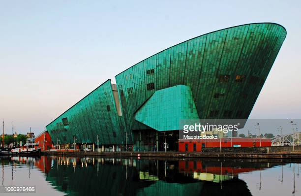 the nemo museum of amsterdam at twilight. - nemo museum stock pictures, royalty-free photos & images