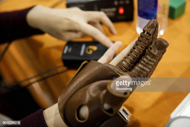 The Neofect Co NeoMano wearable robot glove is demonstrated at the 2018 Consumer Electronics Show in Las Vegas Nevada US on Thursday Jan 11 2018...