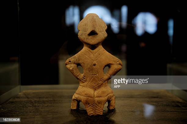The Neolithic Goddess on the Throne a terracotta figurine is displayed on February 22 2013 at the Museum of Kosovo in Pristina Seven Kosovo...