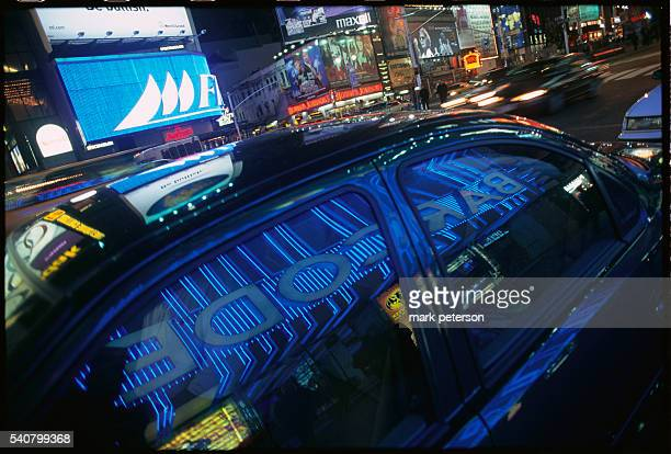 The neon sign outside Bar Code reflects in the windows of a car in Times Square Bar Code is a video arcade bar in Times Square where DJ's play music...