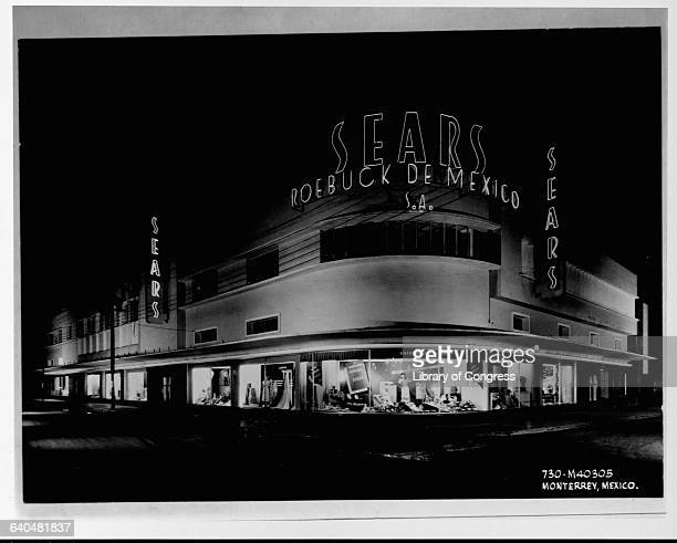 The neon signs of a Sears store glow in the night in Monterrey Mexico