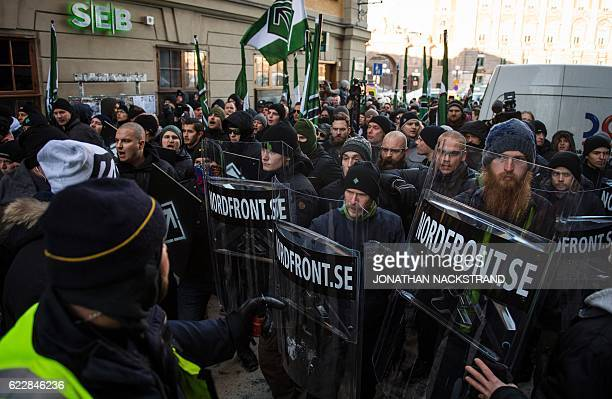 The neonazi Nordic Resistance Movement sympathisers demonstrate in central Stockholm on November 12 2016 to protest against migrants / AFP / JONATHAN...