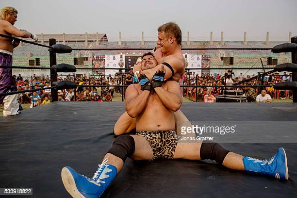 The Nepalese wrestler Nuwakot Tiger fighting with his opponent from New Zealand in the ring The first international wrestling competition was held at...