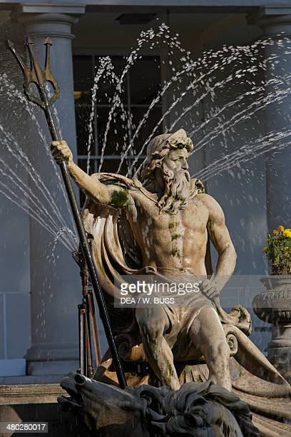 The Neptune fountain with the Regency style Municipal offices in the background, Cheltenham, Gloucestershire, United Kingdom.