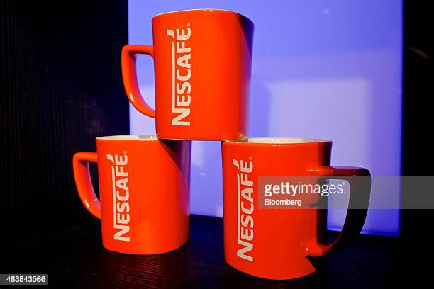 The Nescafe logo sits on coffee mugs at the Nestle SA headquarters in Vevey Switzerland on Thursday Feb 19 2015 Nestle the world's biggest food...
