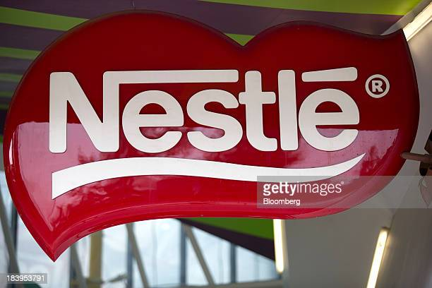 The Nestle SA logo is displayed at the company's chocolate production plant plant in Toluca Mexico on Wednesday Oct 2013 Nestle SA the worlds biggest...