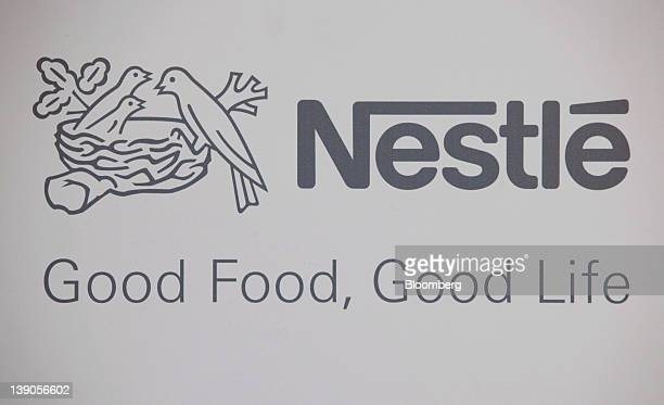 The Nestle SA logo is displayed during the company's results news conference in Vevey Switzerland on Thursday Feb 16 2012 Nestle SA the world's...