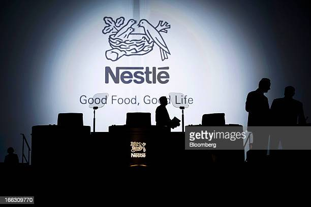 The Nestle SA logo sits on display behind the stage ahead of the company's annual general meeting in Lausanne Switzerland on Thursday April 11 2012...
