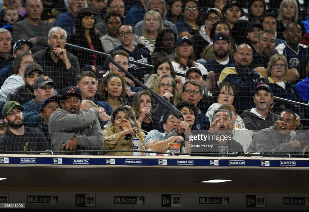 The net stops a flying bat lost by Franmil Reyes #32 of the San Diego Padres from hitting fans during the second inning of a baseball game against the Atlanta Braves at PETCO Park on June 5, 2018 in San Diego, California. The net over the dugout was added in 2018.