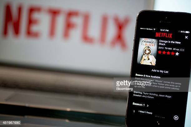 The Netflix Inc application displays the 'Orange is the New Black' series on an Apple Inc iPhone 5s in this arranged photograph in Washington DC US...