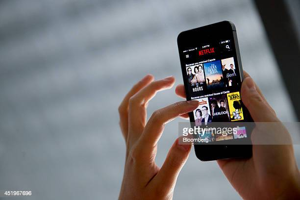 The Netflix Inc application is demonstrated on an Apple Inc iPhone 5s in this arranged photograph in Washington DC US on Wednesday July 9 2014 'House...