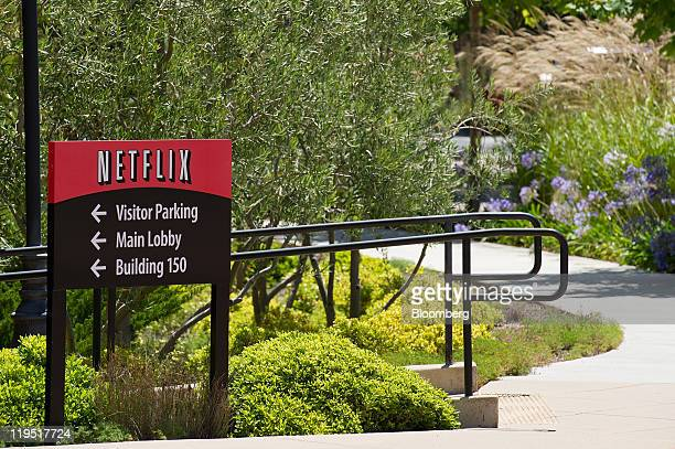 The Netflix Inc logo is displayed on a sign at the company's headquarters in Los Gatos California US on Thursday July 21 2011 Neflix Inc will be...