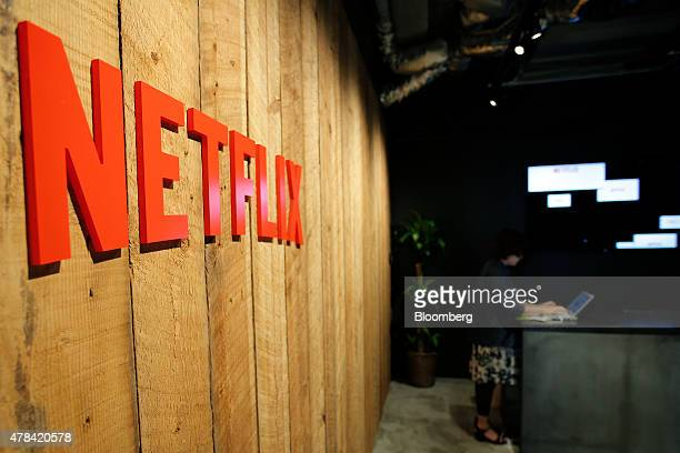 The Netflix Inc logo is displayed on a wall at the Netflix Japan office in Tokyo Japan on Thursday June 25 2015 Netflix plans more alliances with...
