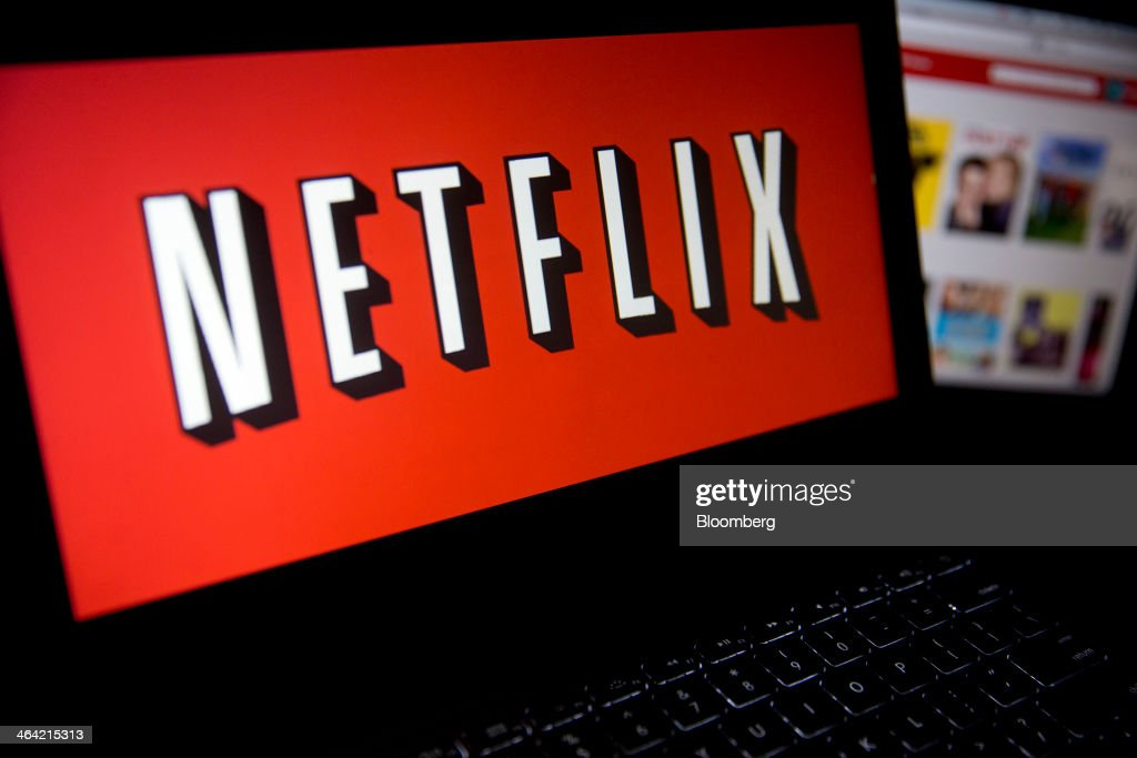 The Netflix Inc. website and logo are displayed on laptop computers arranged for a photograph in Washington, D.C., U.S., on Tuesday, Jan. 21, 2014. Netflix Inc., the largest subscription streaming service, is expected to release earnings data on Jan. 22. Photographer: Andrew Harrer/Bloomberg via Getty Images