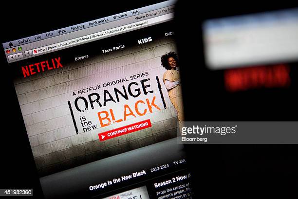 The Netflix Inc website displays the Orange is the New Black series on a laptop computer in this arranged photograph in Washington DC US on Thursday...