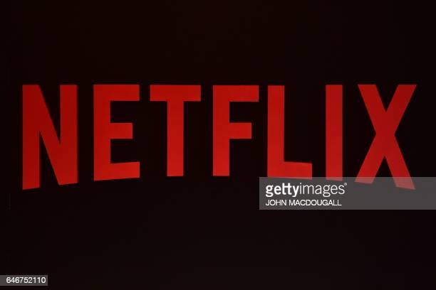 The Netflix logo is pictured during a Netflix event on March 1, 2017 in Berlin. / AFP PHOTO / John MACDOUGALL
