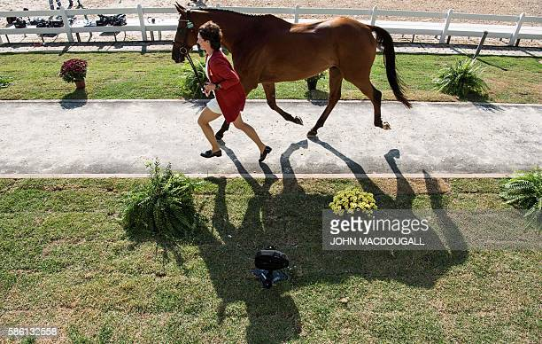 The Netherlands Alice NaberLozeman leads Peter Parker to a trot during the first horse inspection of the Equestrian's Eventing phase during the 2016...