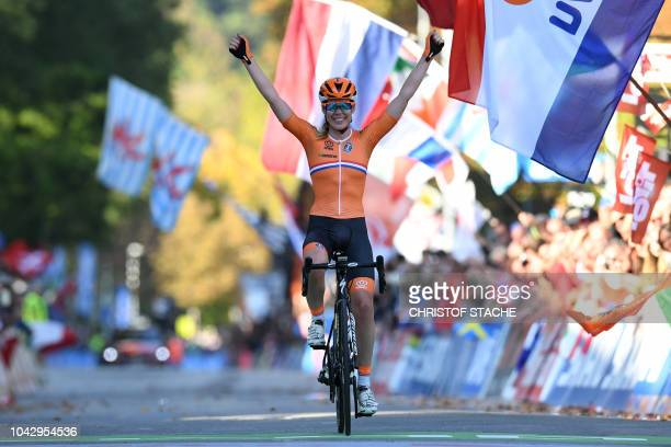 The Netherland's Anna Van Der Breggen celebrates after winning the Women's Elite road race of the 2018 UCI Road World Championships in Innsbruck,...
