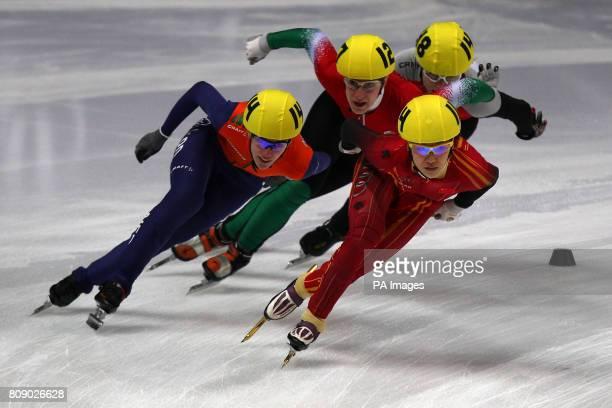 The Netherlands' Annita Van Doorn and China's Qiuhong Liu lead Hungary's Szandra Lajtos and Poland's Patrycja Maliszewska during the Women's 1500m...
