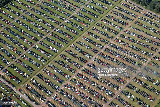 the netherlands, biddinghuizen, cars on parking. - biddingshuizen stockfoto's en -beelden