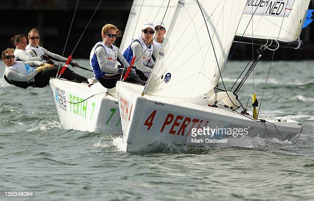 The Netherlands boat skippered by Mandy Mulder and crew of Merel Witteveen and Annemiek Bekkering compete against the Spanish boat skippered by...