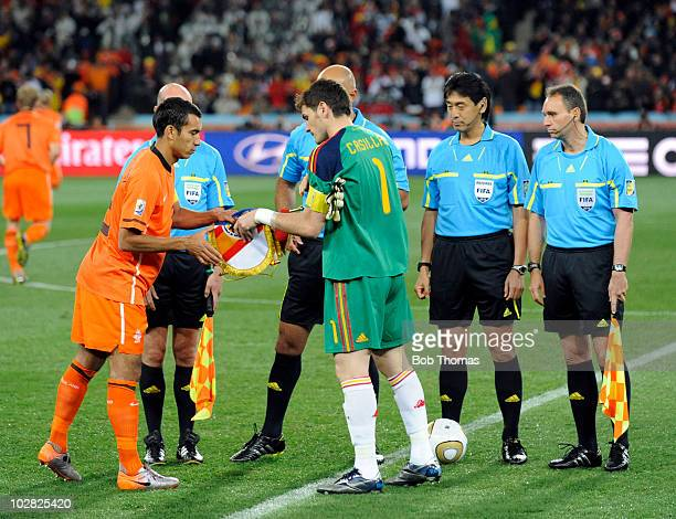 The Netherlands captain Giovanni Van Bronckhorst exchanges pennants with Spanish captain Iker Casillas before the start of the 2010 FIFA World Cup...