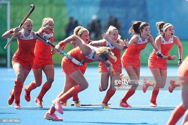 The Netherlands celebrate victory in the penalty shootout during the womens semifinal match between the Netherlands and Germany on Day 12 of the Rio...