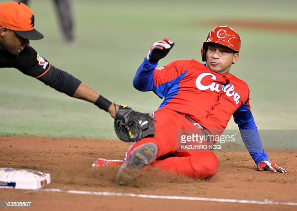 The Netherlands Curt Smith tags out Cuba's Frederich Cepeda during the second inning of their second-round Pool 1 game in the World Baseball Classic...