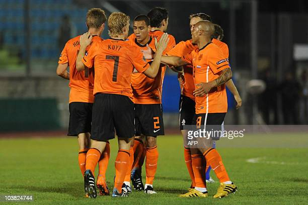 The Netherland's Dirk Kuyt celebrates with his teammates after scoring during the European 2012 qualifying football match between San Marino and the...