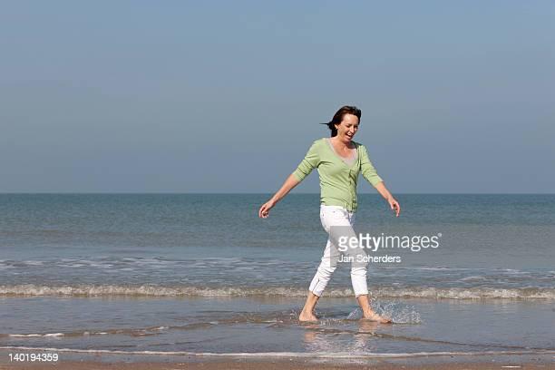 The Netherlands, Domburg, Woman on beach