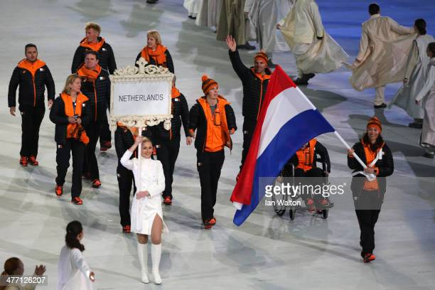 The Netherlands enter the arena lead by flag bearer Bibian MentelSpee during the Opening Ceremony of the Sochi 2014 Paralympic Winter Games at Fisht...