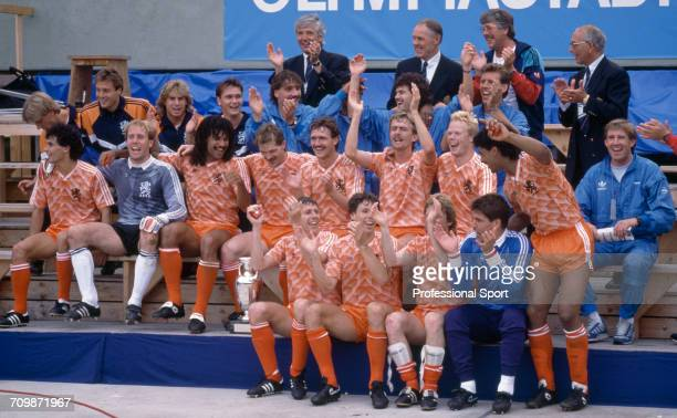 The Netherlands football team celebrate with the UEFA European Championship trophy after Netherlands beat the Soviet Union 20 to become champions in...