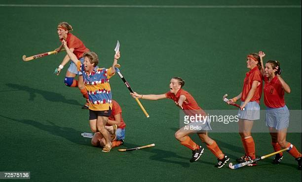The Netherlands hockey team celebrate their bronze medal victory over Great Britain at Morris Brown College at the 1996 Centennial Olympic Games in...
