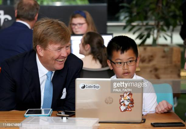 The Netherlands' King WillemAlexander chats with kids at CoderDojo a global movement of free volunteerled communitybased computer programming clubs...