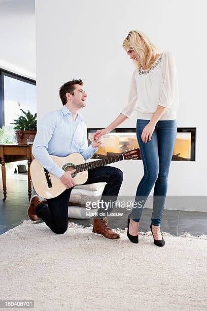 The Netherlands, Man playing guitar in front of woman