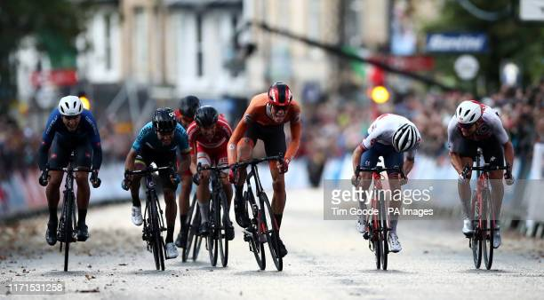 The Netherlands' Nils Eekhoff crosses the line first but is disqualified after the race, giving Italy's Samuele Battistella the gold during the Men's...