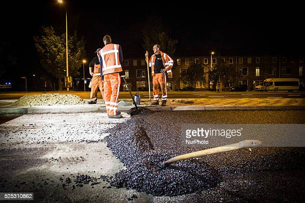 The Netherlands - Part of the entrance road to the university city is given a new top layer of asphalt. Such work is increasingly being done at...