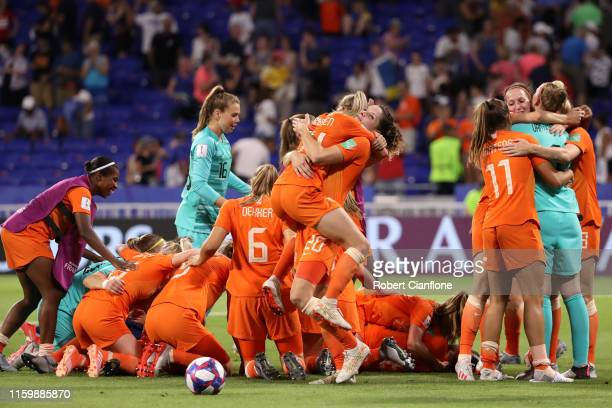 The Netherlands players celebrate following their sides victory in the 2019 FIFA Women's World Cup France Semi Final match between Netherlands and...