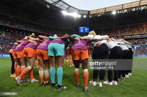 The Netherlands players huddle on the pitch prior to the 2019 FIFA Women's World Cup France Semi Final match between Netherlands and Sweden at Stade...