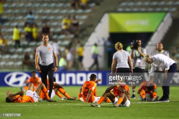 The Netherlands players look dejected after their defeat in a penalty shootout during the FIFA U-17 World Cup Brazil 2019 semi-final match between...